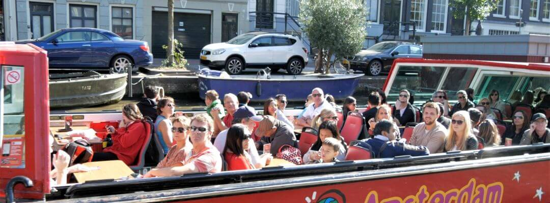 A Hop on Hop off Boat on the Amsterdam Canals for Unlimited Sightseeing